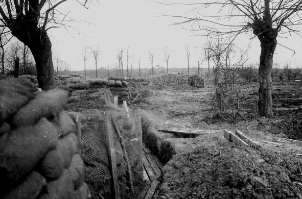 Breastworks near Messines. The high water table prevented digging trenches and the lack of shelter referred to by Lieutenant Colonel Blacker is evident. The enemy occupied the high ground in the distance.